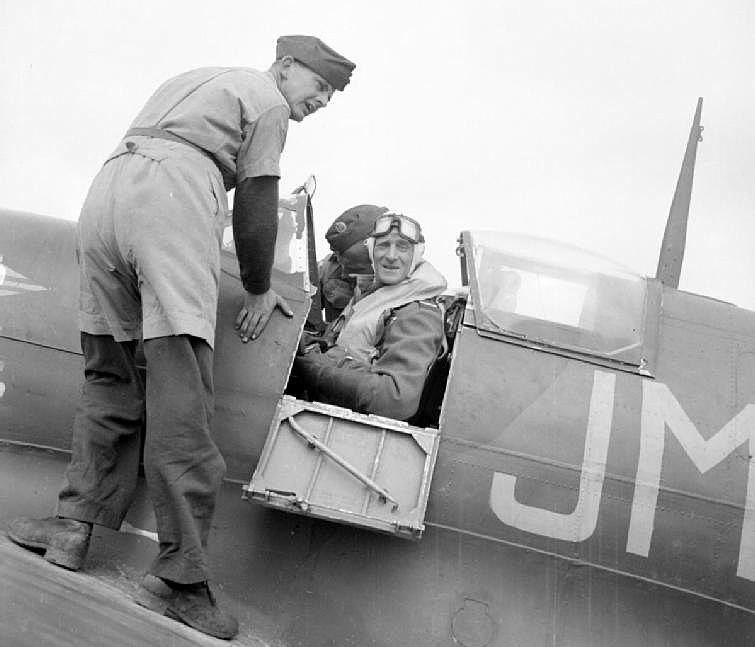 Keith Park being strapped into his Spitfire during the Battle of Malta