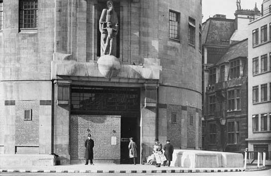 The reinforced entrance to Broadcasting House in London with Policeman on guard outside - 1940